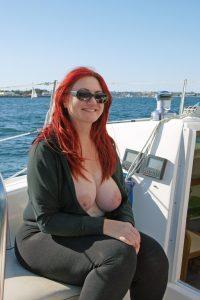 curvy-redhead-flashing-big-tits